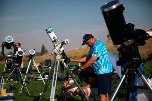"CASPER, WY - AUGUST 21:  People set up cameras and telescopes to watch the solar eclipse at South Mike Sedar Park on August 21, 2017 in Casper, Wyoming.  Millions of people have flocked to areas of the U.S. that are in the ""path of totality"" in order to experience a total solar eclipse. During the event, the moon will pass in between the sun and the Earth, appearing to block the sun.  (Photo by Justin Sullivan/Getty Images)"