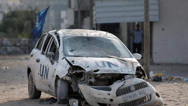 A United Nations aid agency car lies destroyed by shrapnel from an Israeli strike in the Jebaliya refugee camp, northern Gaza Strip, Tuesday, July 29, 2014. UN aid agency worker Mounir Haggar and his brother Bassir who were in the car were killed and Mounir's son Ibrahim, 12, was wounded, according to the UN. (AP Photo/Lefteris Pitarakis)