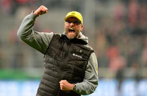 (FILES) A picture taken on April 28, 2015 shows Dortmund's headcoach Juergen Klopp celebrating after the German Cup DFB Pokal semi-final football match FC Bayern Munich v Borussia Dortmund in Munich, southern Germany. Juergen Klopp is one of the leading candidates to succeed sacked Liverpool manager Brendan Rodgers, according to reports in the British media on October 5, 2015. AFP PHOTO / CHRISTOF STACHECHRISTOF STACHE/AFP/Getty Images