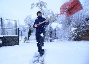 Pacemaker Press Belfast 08-12-2017:  Heavy snow showers overnight have led to disruption across parts of Northern Ireland. Dozens of schools have been closed due to the wintery conditions. The snowfall means an unexpected day off for some young people. Police are advising road users to use extreme caution on the roads. Patrick Morgan pictured enjoying the snow. Picture By: Arthur Allison/Pacemaker.