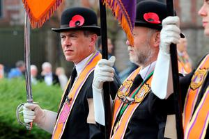 Orangemen lead the main parade as the main 12th July parade moves off from Carlisle circus in Belfast, on July 12, 2016. 12th July is the main marching day in the Orange Order calendar. The parades mark the 326th anniversary of King William III's victory at the Battle of the Boyne in 1690. / AFP PHOTO / PAUL FAITHPAUL FAITH/AFP/Getty Images