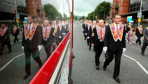 Orangemen lead as the main 12th July parade moves off from Carlisle circus in Belfast, on July 12, 2016. 12th July is the main marching day in the Orange Order calendar. The parades mark the 326th anniversary of King William III's victory at the Battle of the Boyne in 1690. / AFP PHOTO / PAUL FAITHPAUL FAITH/AFP/Getty Images