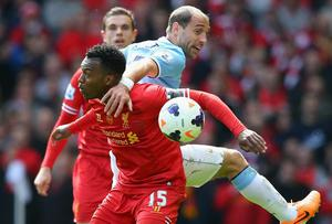 Pablo Zabaleta of Manchester City tangles with Daniel Sturridge of Liverpool during the Barclays Premier League match between Liverpool and Manchester City at Anfield on April 13, 2014 in Liverpool, England.  (Photo by Alex Livesey/Getty Images)