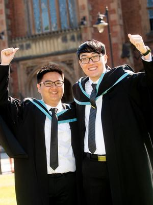Pictured today at Queen's University Belfast is (l-r) Vincent Yapranz from Indonesia who graduated with a degree in Software and Electronic Systems Engineering and Min Harn Lim from Malysia who graduated with a degree in Electrical and Electronic Engineering.