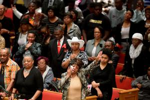 BALTIMORE, MD - APRIL 27:  Mourners sing and pray during Freddie Gray's funeral at the New Shiloh Baptist Church during his funeral April 27, 2015 in Baltimore, Maryland. Gray, 25, was arrested for possessing a switch blade knife April 12 outside the Gilmor Homes housing project on Baltimore's west side. According to his attorney, Gray died a week later in the hospital from a severe spinal cord injury he received while in police custody.  (Photo by Chip Somodevilla/Getty Images)