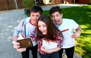 Picture - Kevin Scott / Belfast Telegraph  Belfast - Northern Ireland - Thursday 13th August 2015 - A Level Results Day   Pictured is Stephen Hare, Sophie Fusco McKeown and Toni Salami taking a selfie during A level results day at Lagan Collage  Picture - Kevin Scott / Belfast Telegraph