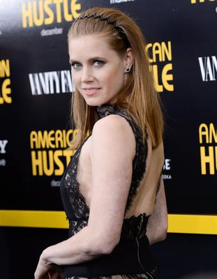 """FILE - This Dec. 8, 2013 file photo shows actress Amy Adams at the premiere of """"American Hustle"""" at the Ziegfeld Theatre in New York.  Adams was nominated for an Academy Award for best actress on Thursday, Jan. 16, 2014, for her role in the film. The 86th Academy Awards will be held on March 2. (Photo by Evan Agostini/Invision/AP, File)"""