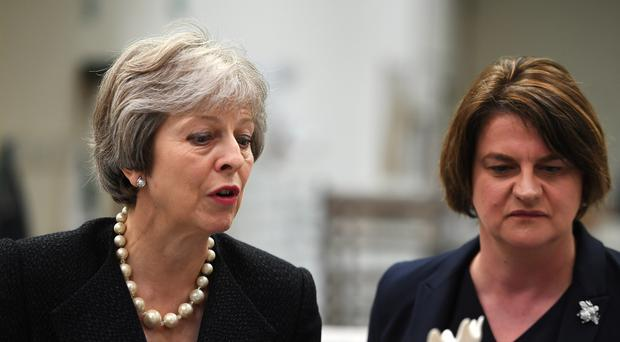 Theresa May, pictured in Northern Ireland with DUP leader Arlene Foster (Clodagh Kilcoyne/PA)