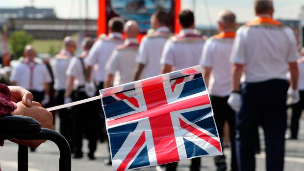A Union flag is seen as Orangemen take part in the annual July 12 parade in Belfast, on July 12, 2017. July 12 is the main marching day in the Orange Order calendar. The parades mark the Protestant commemoration of the 327th anniversary of King William III's victory at the Battle of the Boyne in 1690. / AFP PHOTO / Paul FAITHPAUL FAITH/AFP/Getty Images