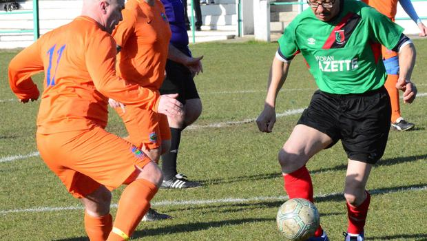 Under control: Alan Gracey on the charge with the Glentoran Legends side