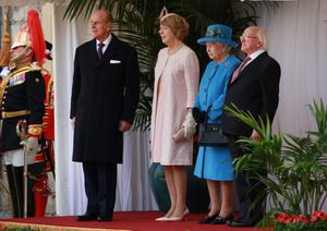 WINDSOR, ENGLAND - APRIL 08: (L-R) Prince Philip, Duke of Edinburgh, Sabina Higgins, Queen Elizabeth II and President of Ireland Michael D Higgins watch a ceremonial welcome at Windsor Castle on April 8, 2014 in England. This is the first official visit by the head of state of the Irish Republic to the United Kingdom.  (Photo by Peter Macdiarmid - WPA Pool/Getty Images)
