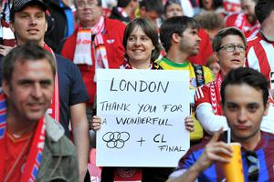 A Bayern Munich fan in the stands holds a banner thanking London for hosting the Olympics and Champions League Final during the UEFA Champions League Final at Wembley Stadium, London. PRESS ASSOCIATION Photo. Picture date: Saturday May 25, 2013.