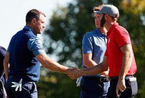 CHASKA, MN - SEPTEMBER 30: Lee Westwood of Europe and Dustin Johnson of the United States shake hands at the end of their match during morning foursome matches of the 2016 Ryder Cup at Hazeltine National Golf Club on September 30, 2016 in Chaska, Minnesota.  (Photo by Streeter Lecka/Getty Images)