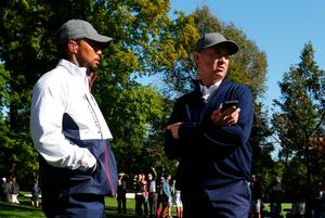 CHASKA, MN - SEPTEMBER 30:  Vice-captain Tiger Woods and captain Davis Love III of the United States speak during morning foursome matches of the 2016 Ryder Cup at Hazeltine National Golf Club on September 30, 2016 in Chaska, Minnesota.  (Photo by Streeter Lecka/Getty Images)