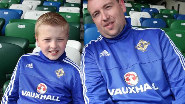 @Press Eye Ltd Northern Ireland- 27th May 2016 Mandatory Credit -Brian Little/Presseye  Darren Hamill and son Scott, aged 10, from Lisburn watching  Northern Ireland     and Belarus      during Friday night's Vauxhall Friendly International match  at the National Football Stadium at Windsor Park. Picture by Brian Little/Presseye