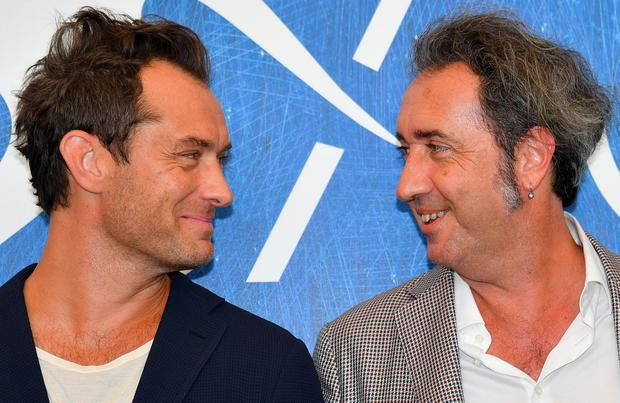 Italian director Paolo Sorrentino, right, and British actor Jude Law pose during a photocall for 'The Young Pope' at the Venice Film Festival in Venice, Italy, Saturday, Sept. 3, 2016. (Ettore Ferrari/ANSA via AP)