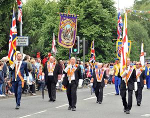 PACEMAKER BELFAST  13/07/2015 12th July celebrations in Derriaght/Dunmurry today Hillsborough District Colour Party pass Seymore Hill on their way to the field at Dunnmurry