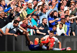 Chelsea's Belgian midfielder Eden Hazard clashes with Arsenal's Brazilian defender Gabriel as the Chelsea fan react during the English Premier League football match between Chelsea and Arsenal at Stamford Bridge in London on September 19, 2015. AFP PHOTO / BEN STANSALL   RESTRICTED TO EDITORIAL USE. No use with unauthorized audio, video, data, fixture lists, club/league logos or 'live' services. Online in-match use limited to 75 images, no video emulation. No use in betting, games or single club/league/player publications.BEN STANSALL/AFP/Getty Images