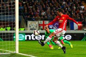 First blood: Henrikh Mkhitaryan nets the opener in United's 1-1 Europa League draw in Belgium. Photo: Clive Rose/Getty Images