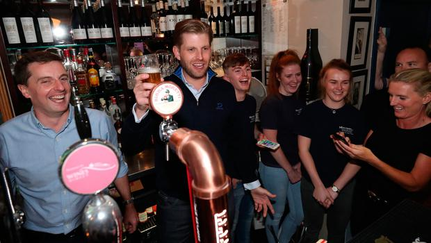 Eric Trump, the son of US President Donald Trump, pours drinks and meets locals in the village of  Doonbeg in Co Clare, on the first day of US President Donald Trump's visit to the Republic of Ireland. PRESS ASSOCIATION Photo. Picture date: Wednesday June 5, 2019. See PA story IRISH Trump. Photo credit should read: Niall Carson/PA Wire