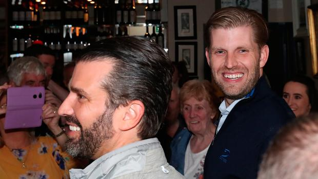 Donald Trump Jr. (left) and Eric Trump, the sons of US President Donald Trump, pour drinks and meet locals in the village of Doonbeg in Co Clare, on the first day of US President Donald Trump's visit to the Republic of Ireland. PRESS ASSOCIATION Photo. Picture date: Wednesday June 5, 2019. See PA story IRISH Trump. Photo credit should read: Niall Carson/PA Wire