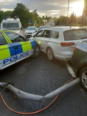 A man has been arrested after crashing into a number of police vehicles
