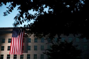 ARLINGTON, VA - SEPTEMBER 11:  Pentagon personnel unfurl a large American flag on the west side of the Pentagon September 11, 2015 in Arlington, Virginia. The nation remembered the lives that were lost in the 9/11 attacks on its 14th anniversary.  (Photo by Alex Wong/Getty Images)