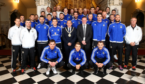 Well done boys: Belfast Lord Mayor Arder Carson welcomes Northern Ireland boss Michael O'Neill and his men to City Hall for a civic reception last night following their qualification for the Euro 2016 finals