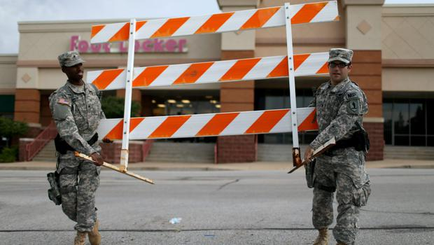 Missouri National Guard troops are deployed to provide protection for a police command centre on August 19, 2014 in Ferguson, Missouri. Violent outbreaks have taken place in Ferguson since the shooting death of unarmed teenager Michael Brown by a Ferguson police officer on August 9.  (Photo by Joe Raedle/Getty Images)