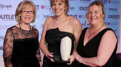 So supportive: Rachel Smith receives the Woman of the Year in the Voluntary sector award from Kathleen Lavery-Boulouda, general manager of the Ramada Plaza. Also pictured is host Wendy Austin.