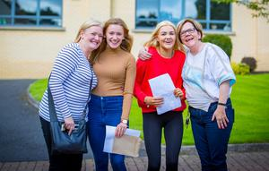 Cliona Thompson and Cathrine Jackson with their parents from Dominican College Fortwilliam as they receive GCSE results on August 24th 2017 (Photo by Kevin Scott / Belfast Telegraph)