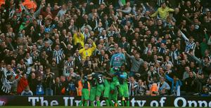 Newcastle United fans celebrate their second goal during the Barclays Premier League match at the Hawthorns, West Bromwich. David Davies/PA Wire.