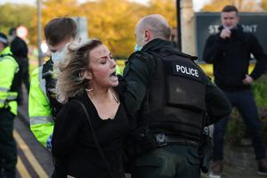 Press Eye - Belfast - 18th October 2020 -   Members of the public take part in a 'Peaceful Gathering'  in the grounds of Stormont Estate, Belfast.   The event was advertised as a peaceful gathering opposing the 'mandatory wearing of masks, lockdowns and fear mongering'.  PSNI officers  made several arrests at the event and issued tickets.   Photo by Kelvin Boyes / Press Eye.
