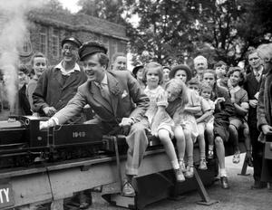 File photo dated 25/07/50 of Richard Attenborough driving children on a train as Lord Attenborough has died aged 90, the BBC reported tonight. PRESS ASSOCIATION Photo. Issue date: Sunday August 24, 2014. See PA story DEATH Attenborough. Photo credit should read: PA Wire