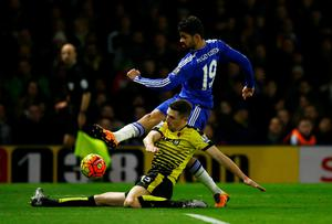 No way through: Watford and Northern Ireland defender Craig Cathcart denies Chelsea ace Diego Costa in the goalless draw