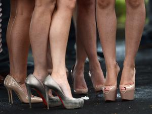 1/6/2013. Guests displaying killer heels at the wedding of Helen McConnell to Manchester United and Northern Ireland football star Jonny Evans at Clough Presbyterian Church in County Antrim this afternoon. Picture Charles McQuillan/Pacemaker.