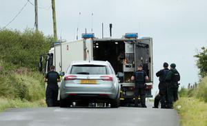 Security forces attend the scene of a security alert on Wheelers Road, Hannahstown, Belfast following the discovery of  a suspicious device.  Photo by Kelvin Boyes / Press Eye.