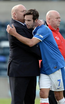 Double act: David Jeffrey gives Andy Waterworth a smacker after substituting the striker in a game against Glenn Ferguson's Ballymena United side at Windsor Park in 2013. Photo: Charles McQuillan/Pacemaker