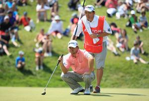 PARIS, FRANCE - JULY 07:  Graeme McDowell of Northern Ireland with his caddy Ken Comboy during the final round of the Alstom Open de France at Le Golf National on July 7, 2013 in Paris, France.  (Photo by Richard Heathcote/Getty Images)
