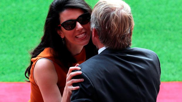 "Former Liverpool player and manager Kenny Dalglish is greeted by Linda Pizzuti wife of Liverpool owner John W Henry during the opening of the Anfield Main Stand, Liverpool. PRESS ASSOCIATION Photo. Picture date: Friday September 9, 2016. Photo credit should read: Peter Byrne/PA Wire. RESTRICTIONS: EDITORIAL USE ONLY No use with unauthorised audio, video, data, fixture lists, club/league logos or ""live"" services. Online in-match use limited to 75 images, no video emulation. No use in betting, games or single club/league/player publications."