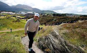 Ireland's Padraig Harrington makes his way onto the 11th green with the mountains of Mourne in the background on the first day of the Irish Open at the Royal County Down Golf Club in Newcastle in Northern Ireland on May 28, 2015. AFP Photo/Paul FaithPAUL FAITH/AFP/Getty Images