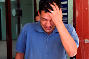 Abdullah Kurdi, 40, father of Syrian boys Aylan, 3, and Galip, 5, who were washed up drowned on a beach near Turkish resort of Bodrum on Wednesday, cries as he waits for the delivery of their bodies outside a morgue in Mugla, Turkey, Thursday, Sept. 3, 2015.(AP Photo/Mehmet Can Meral)