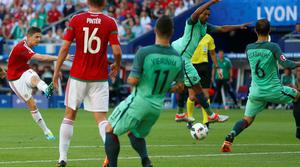 Hungary's Zoltan Gera, left, scores his side's first goal during the Euro 2016 Group F soccer match between Hungary and Portugal at the Grand Stade in Decines-Charpieu, near Lyon, France, Wednesday, June 22, 2016. (AP Photo/Darko Bandic)