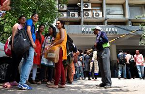People wait outside a building after tremors struck New Delhi on May 12, 2015.  A new earthquake of 7.3-magnitude and several powerful aftershocks hit devastated Nepal on May 12, killing at least four people and sending terrified residents running into the streets of the traumatised capital.    The quake was felt as far away as New Delhi, and officials said it caused buildings to collapse in Chinese-controlled Tibet.   AFP PHOTO /PRAKASH SINGHPRAKASH SINGH/AFP/Getty Images