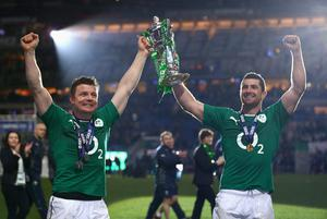 Brian O'Driscoll of Ireland and Dean Kearney of Ireland celebrate with the trophy after winning the six nations championship with a 22-20 victory over France during the RBS Six Nations match between France and Ireland at Stade de France on March 15, 2014 in Paris, France.  (Photo by Paul Gilham/Getty Images)