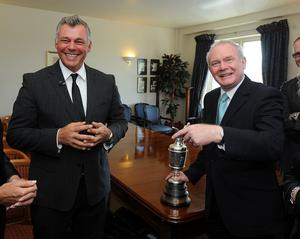 19/7/2011. PACEMAKER PRESS INTL. BELFAST. Darren Clarke returns home to Royal Portrush golf club with the Open trophy he won at the weekend., met by Deputy First Minister Martin McGuinness. Picture Charles McQuillan/Pacemaker.