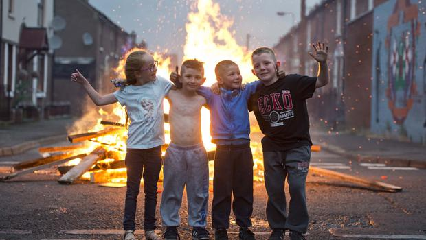 Loyalist area's across Northern Ireland get ready to kick off the 12th of July celebrations with the traditional bonfires. Mark Marlow/Pacemaker Press. Pictured are Kayie Curry with Ryan Morgan Maddox Glass and Kai McNurnan.