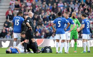 Everton's Gareth Barry lies injured during the Barclays Premier League match at the Stadium of Light, Sunderland. Owen Humphreys/PA Wire.