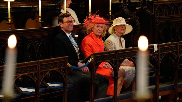 WINDSOR, UNITED KINGDOM - MAY 19: Jack Brooksbank and Emilie van Cutsem (centre) take their seats at St George's Chapel at Windsor Castle before the wedding of Prince Harry to Meghan Markle on May 19, 2018 in Windsor, England. (Photo by  Jonathan Brady - WPA Pool/Getty Images)