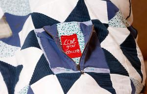 Memento: a touching hand-stitched detail on the special quilt
